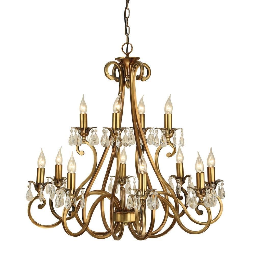Interiors 1900 oksana stylish 12 light chandelier in antique brass oksana stylish 12 light chandelier in antique brass finish with crystal droplets ul1p12b mozeypictures Choice Image